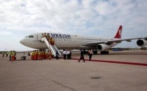 FILE PHOTO: Employees work on a Turkish Airlines plane after its arrival at Aden Abdulle International Airport in Mogadishu Somalia