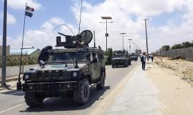 Italian military convoy is seen at the scene of an explosion in Mogadishu, Somalia, 01 October 2018. A car bomb hit a military vehicle near the Defense Ministry in Mogadishu on 01 October, killing at least one person. EPA/SAID YUSUF WARSAME