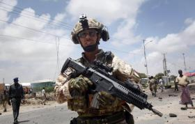 A member of the Italian military attends the scene after an attack on a European Union military convoy in the capital Mogadishu, Somalia Monday, Oct. 1, 2018. A Somali police officer says a suicide car bomber has targeted a European Union military convoy carrying Italian military trainers in the Somali capital Monday. (ANSA/AP Photo/Farah Abdi Warsameh) [CopyrightNotice: Copyright 2018 The Associated Press. All rights reserved.]