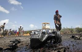 Somali security forces attend the scene after an attack on a European Union military convoy in the capital Mogadishu, Somalia Monday, Oct. 1, 2018. A Somali police officer says a suicide car bomber has targeted a European Union military convoy carrying Italian military trainers in the Somali capital Monday. (ANSA/AP Photo/Farah Abdi Warsameh) [CopyrightNotice: Copyright 2018 The Associated Press. All rights reserved.]