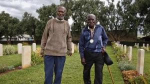 Gershon Fundi and Eusebio Mbiuki pay respects to their fallen comrades at the Nanyuki war cemetery near Mount Kenya. Both men fought for Britain in World War II